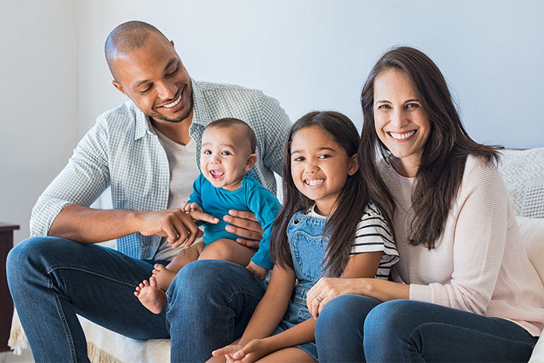 Couple with two children, a young daughter and infant son